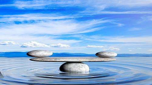 zen stones balancing in water